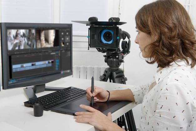 Young female designer using graphics tablet Premium Photo