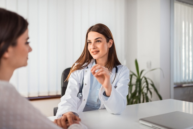Young female doctor talking with a female patient. Premium Photo