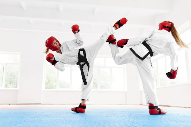 Young female fighter boxing using karate technique. Premium Photo