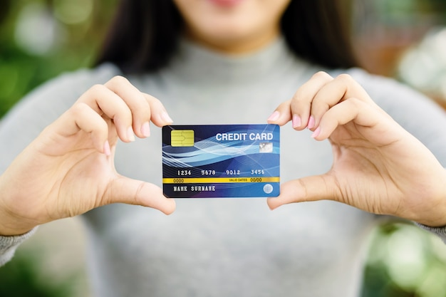 Young female holding credit card Premium Photo