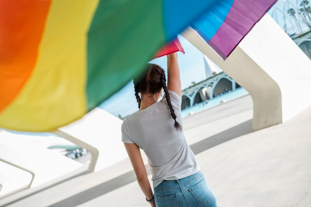 Young female keeping rainbow flag Free Photo