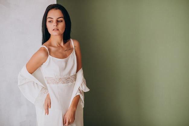 Young female model in sleeping underwear Free Photo