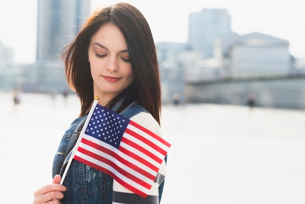 Young female posing with usa flag on independence day Free Photo