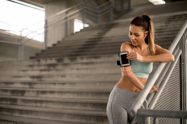 Young female runner resting on stairs Premium Photo