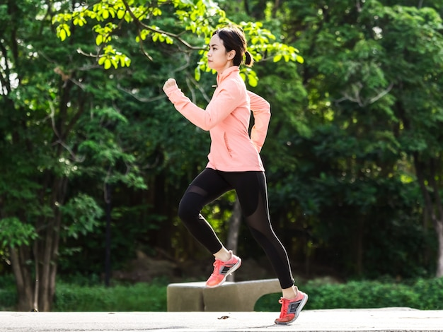 Young female running in the park Premium Photo