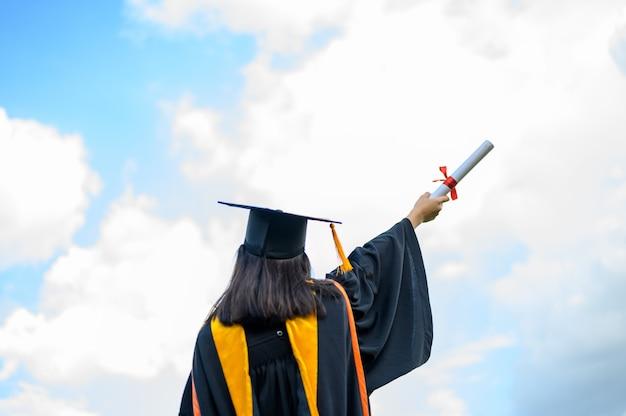 Young female student graduating from university Premium Photo