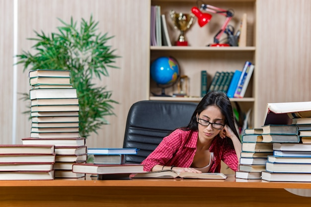 Young female student preparing for college school exams Premium Photo