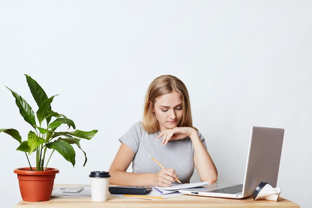 Young female student studying Premium Photo