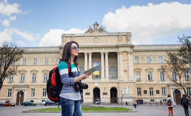 Young female tourist with map and camera Premium Photo