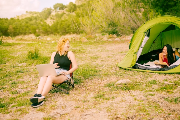 Young females camping in forest Free Photo
