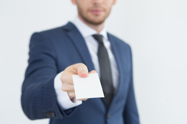 Young financial advisor giving business card Free Photo