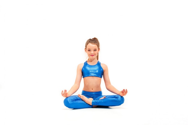 Young fit girl doing yoga exercises on white Free Photo