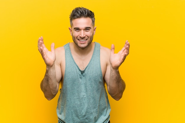 Young fitness man joyful laughing a lot. happiness concept. Premium Photo