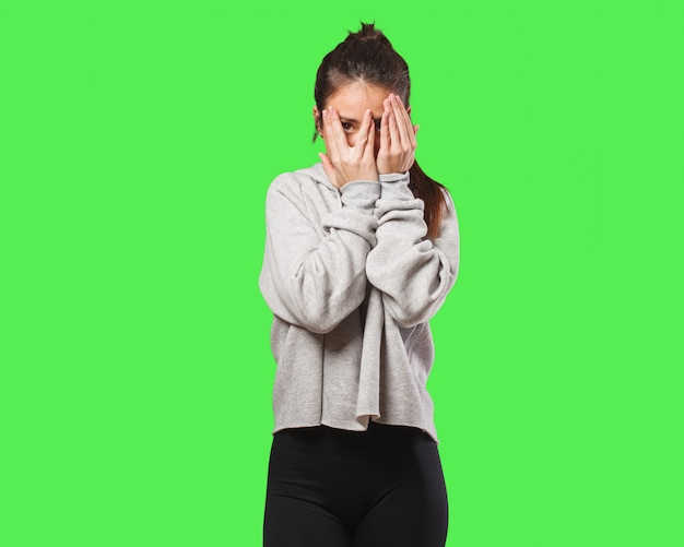 Young fitness woman feels worried and scared Premium Photo