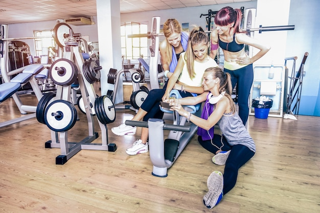 Young fitness women taking selfie with smartphone at gym club Premium Photo