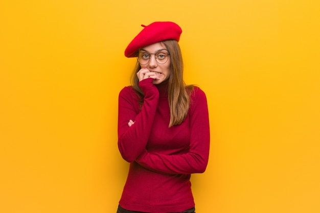 Young french artist woman biting nails, nervous and very anxious Premium Photo
