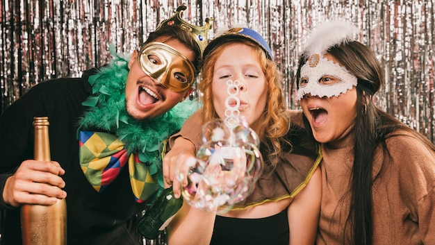 Young friends having fun at carnival party Free Photo