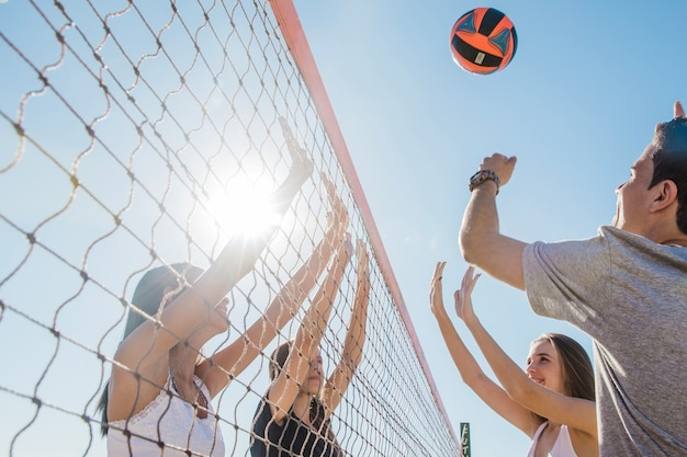 Young friends playing volleyball Photo | Free Download