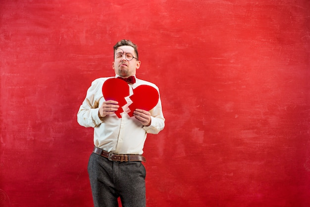 Young funny man with abstract broken heart Free Photo