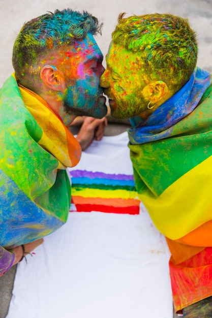 Young gays kissing on holi festival Free Photo