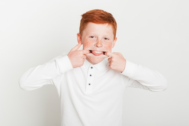 Young ginger boy fooling around Free Photo