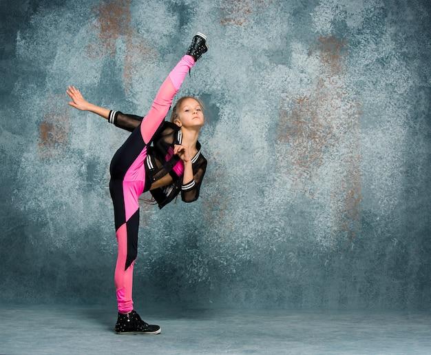 Young girl break dancing on wall Free Photo