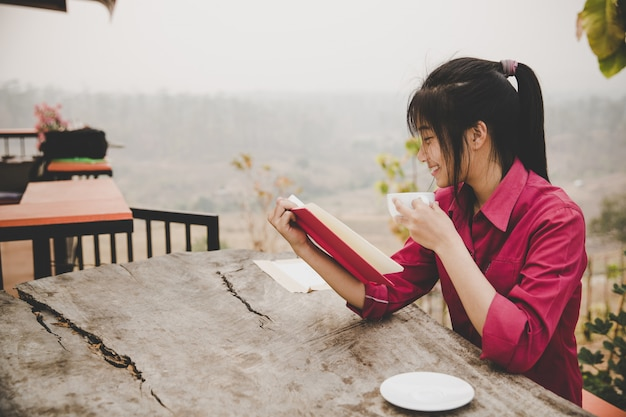 Young girl in the cafe, book, reading, coffee Free Photo