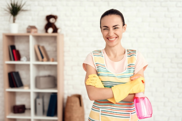 Young girl cleans the house with detergents. Premium Photo
