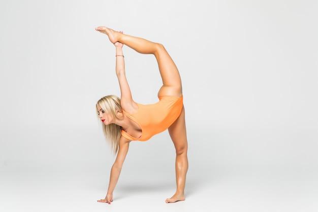 Young girl doing gymnastics exercise isolated Free Photo