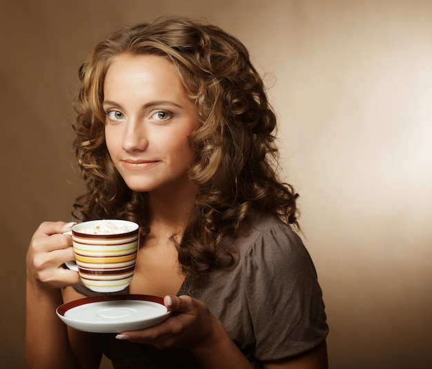Young girl drinking tea or coffee Premium Photo