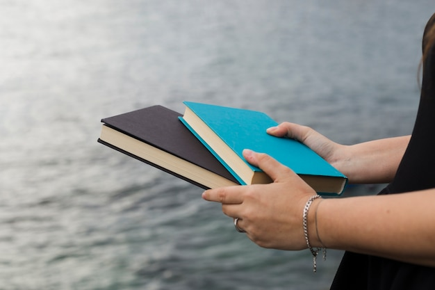Young girl holding a book Free Photo