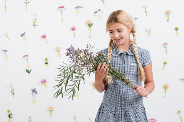 Young girl holding bouquet of flowers Free Photo