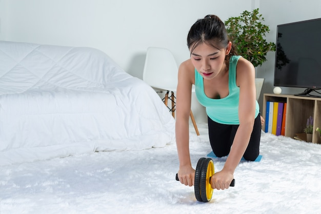 Young girl is working out at home, she is practicing yoga at home.concept of healthy life from virus. Free Photo