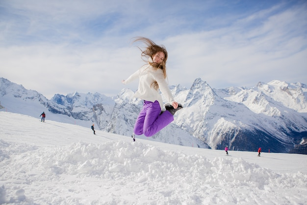 Young girl jumping in a sky slope Premium Photo