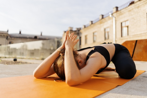 Young girl practicing stretching and yoga workout exercise Free Photo