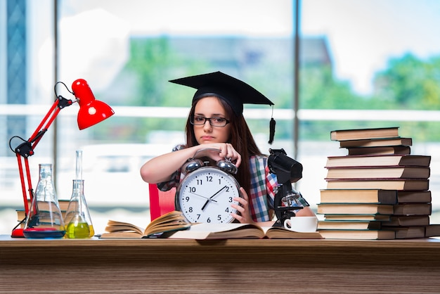 Young girl preparing for exams with large clock Premium Photo
