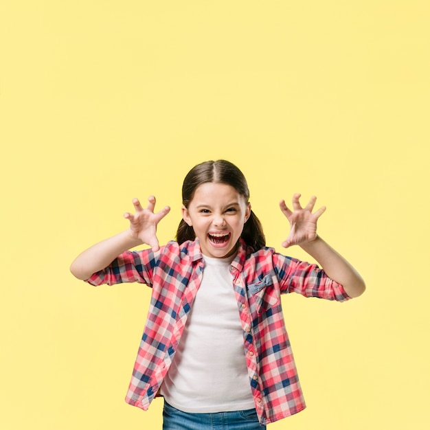 Young girl roaring in studio young Free Photo