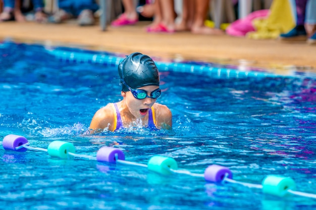 Young girl swimmers practicing lap swimming Premium Photo