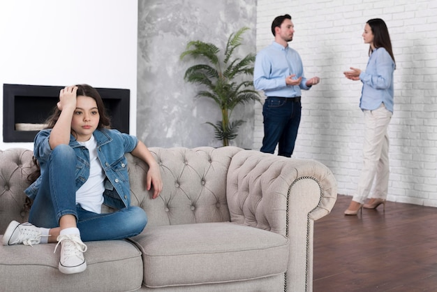 Young girl tired of parents arguing Free Photo