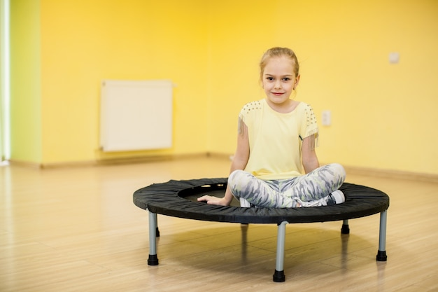 Young girl on trampoline Free Photo