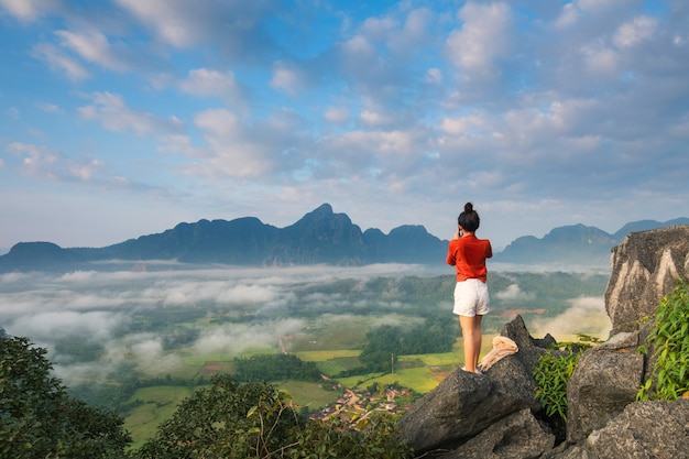 Young girl travels on high mountain in vang-vieng, laos. Premium Photo