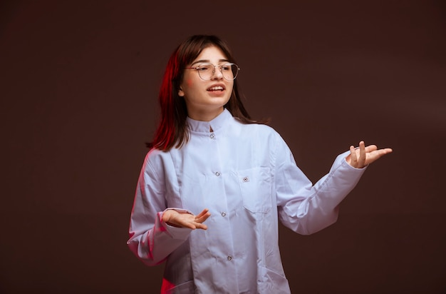 Young girl in white shirt making presentation. Free Photo