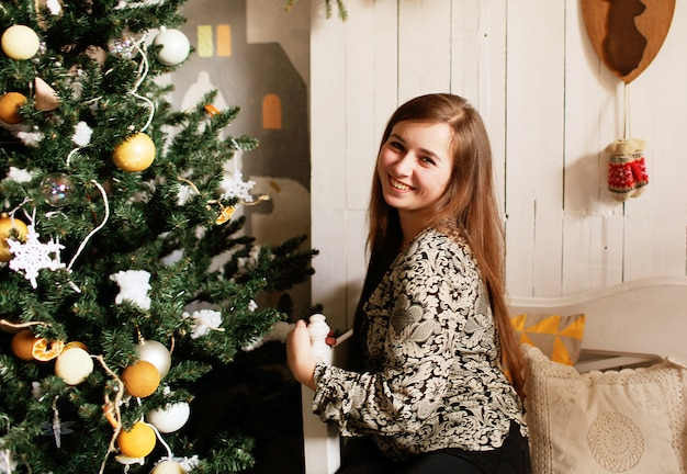 Young girl with christmas decorations Premium Photo