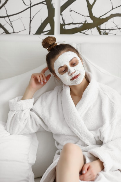 Young Girl With Face Mask Skin Care Young Beautiful Girl Relaxing With Facial Masks On Over White Background Premium Photo