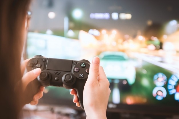 Young girl with gamepad playing games on tv 447 19326887