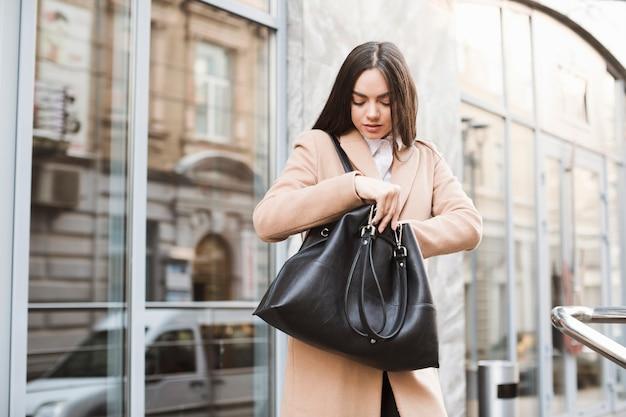 Young girl with handbag on street Free Photo