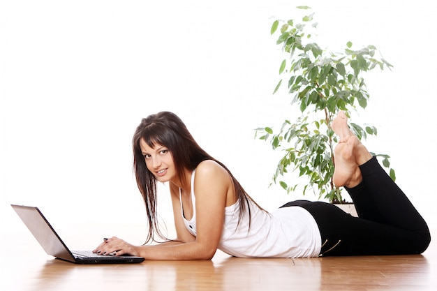 Young girl with laptop at home Free Photo