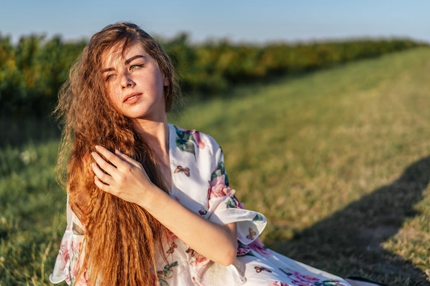Young Girl With Long Curly Hair Brunette Face In Freckles With
