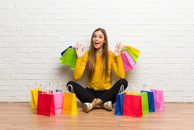 Young girl with lot of shopping bags Premium Photo