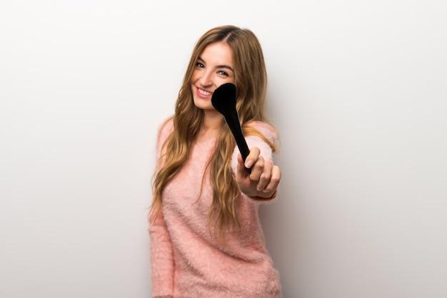 Young girl with makeup brush Premium Photo